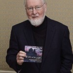 John Williams holding The Fall of the House of Usher CD